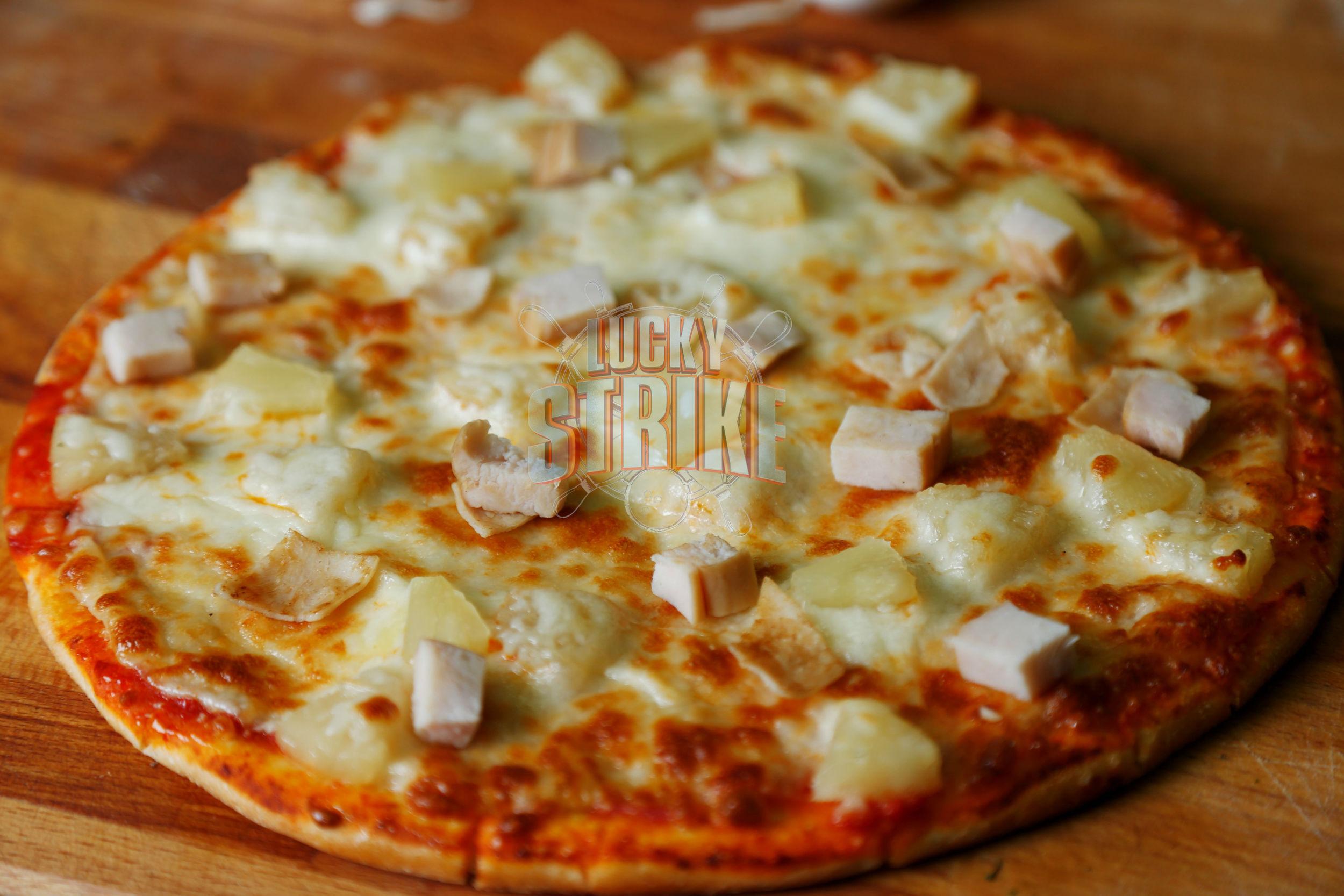 HAWAIIAN PIZZA                           38/49    Freshly homemade dough topped with   turkey breast, pineapple & melted mozzarella cheese & I  talian sauce