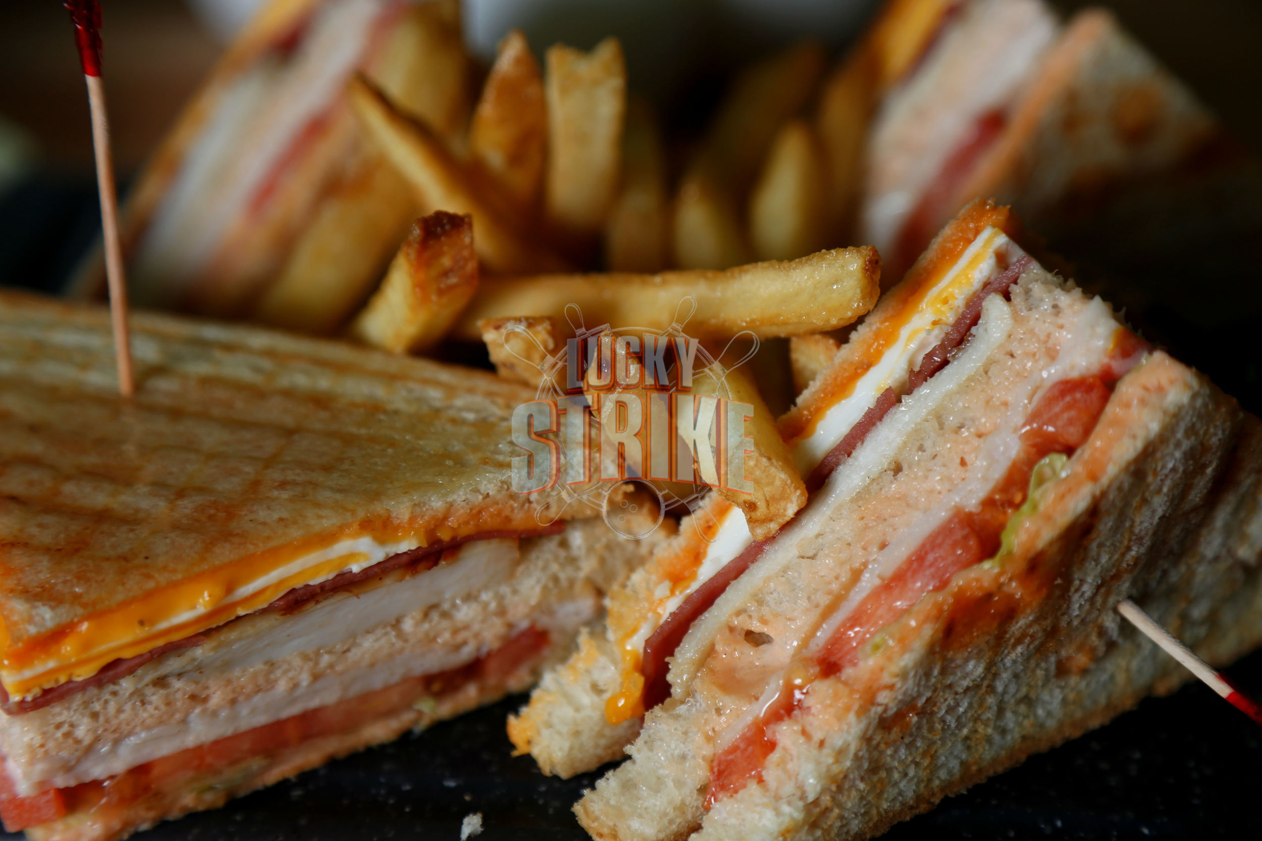 TURKEY CLUB SANDWICH                                          35   Triple decker stacked with grilled chicken, turkey breast, egg, cheese, mayo tomato & lettuce