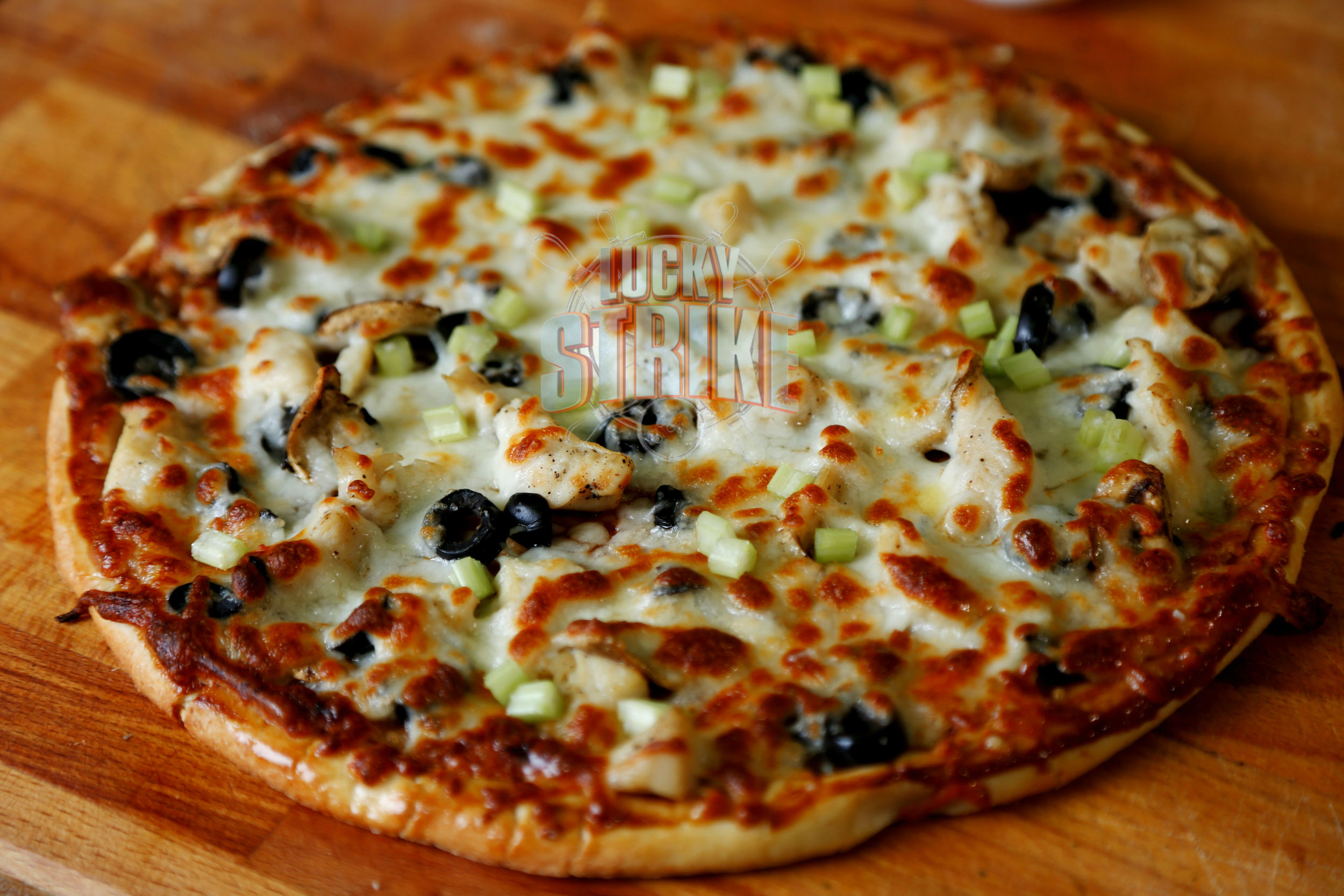 BBQ CHICKEN PIZZA                        40/52    Freshly homemade dough topped with   grilled chicken &marinated with spring onion, mushroom, corn with melted mozzarella cheese & I  talian sauce