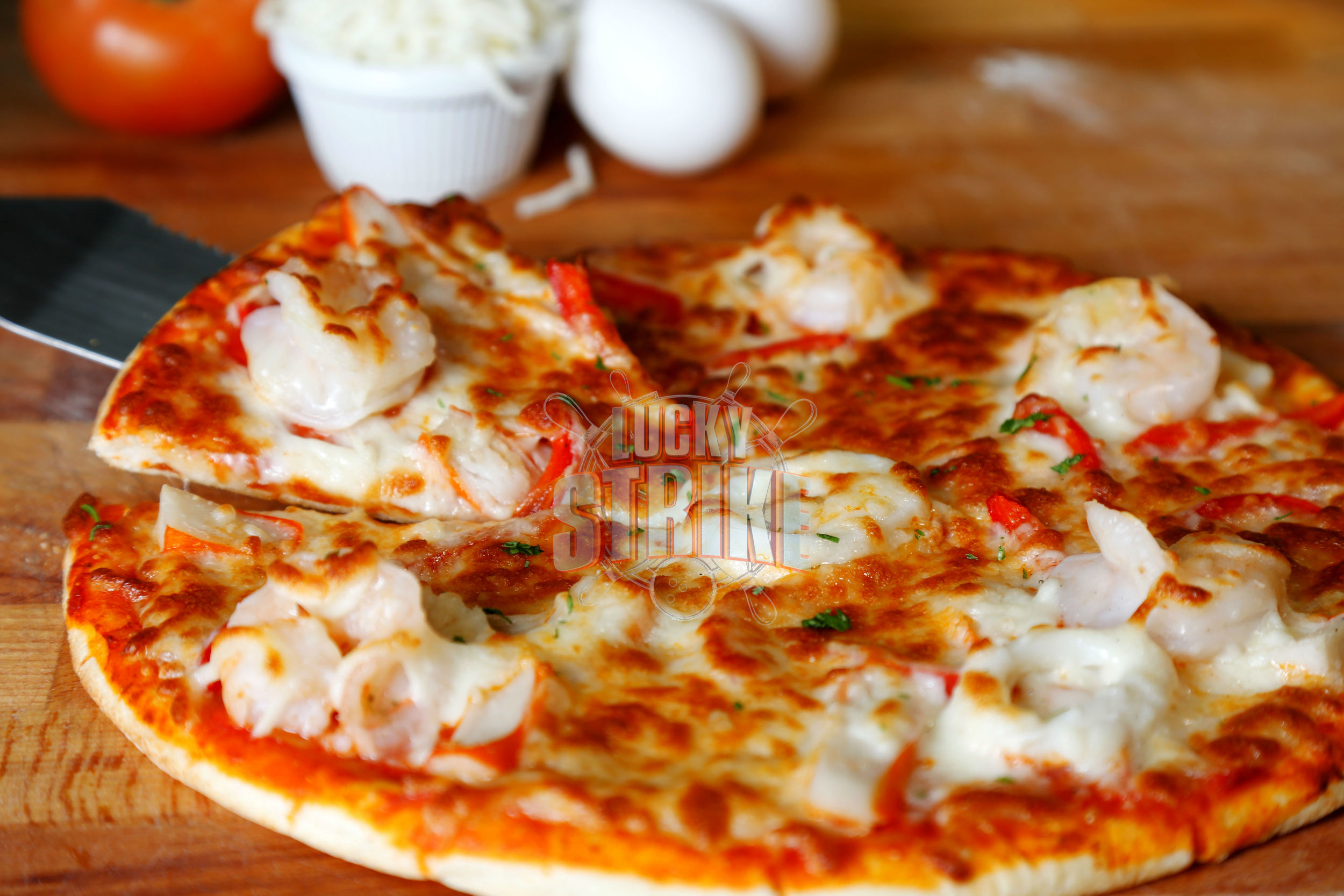 SEAFOOD PIZZA                                                      49/59    Freshly homemade dough topped with shrimp, crab, red & yellow capsicum, parsley, melted mozzarella cheese & Italian sauce
