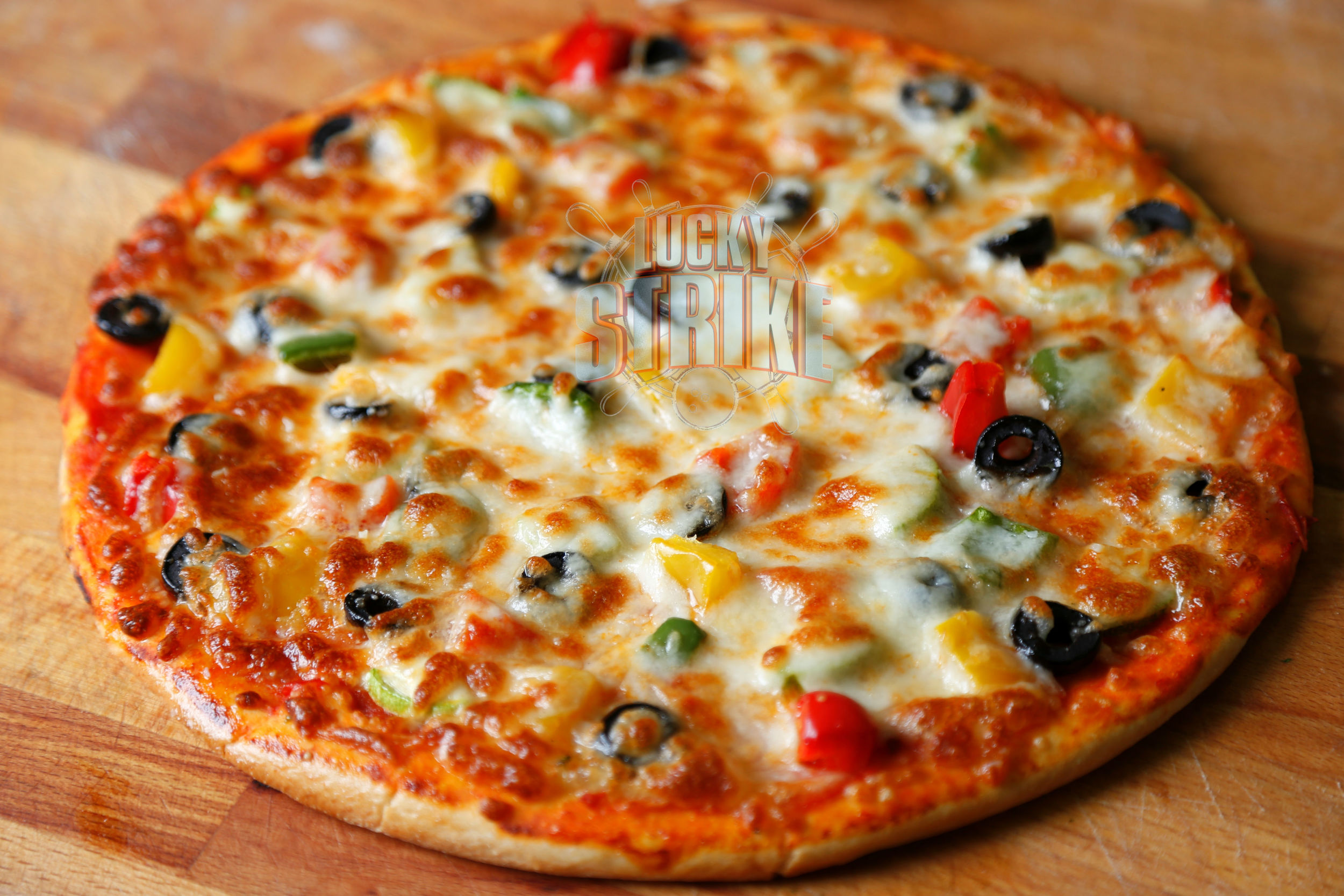 VEGETARIAN PIZZA                         38/49    Freshly homemade dough marinated with tomato. black olives, green & red capsicum, zucchini   with melted mozzarella cheese & I  talian sauce