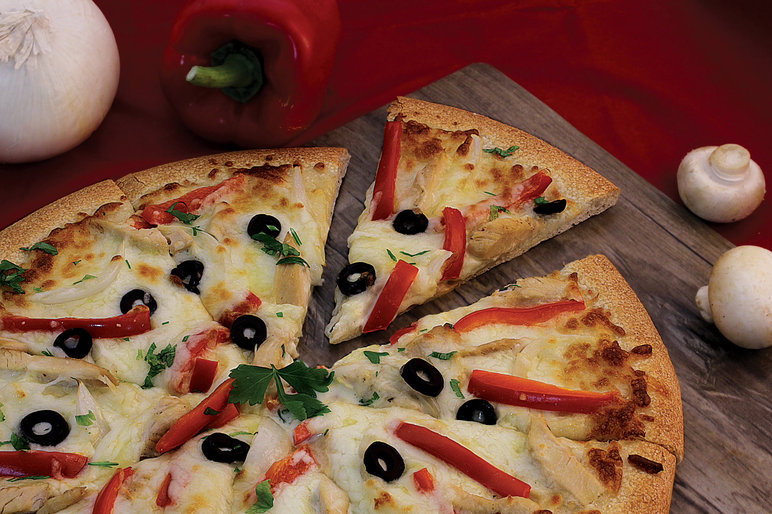 Chicken Alfredo Pizza                       45/55   Freshly homemade dough topped with   chicken, onion, red capsicum, black olives & melted mozzarella cheese & alfredo s  auce
