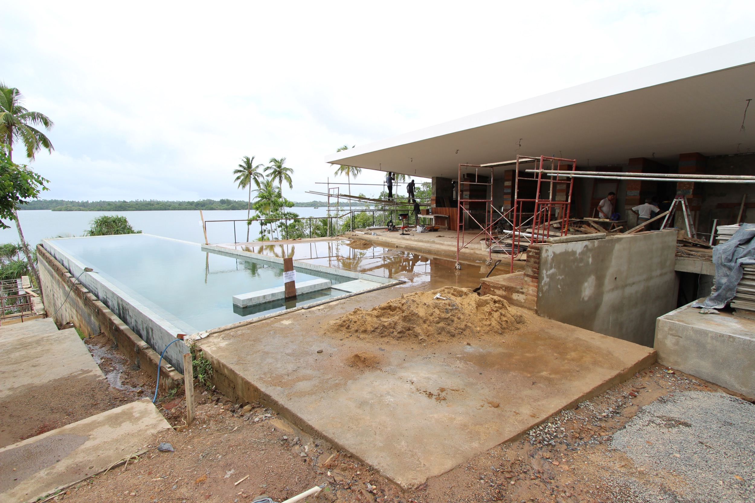 Main house with the infiniti pool almost finished. Columns getting clad in reclaimed wood.