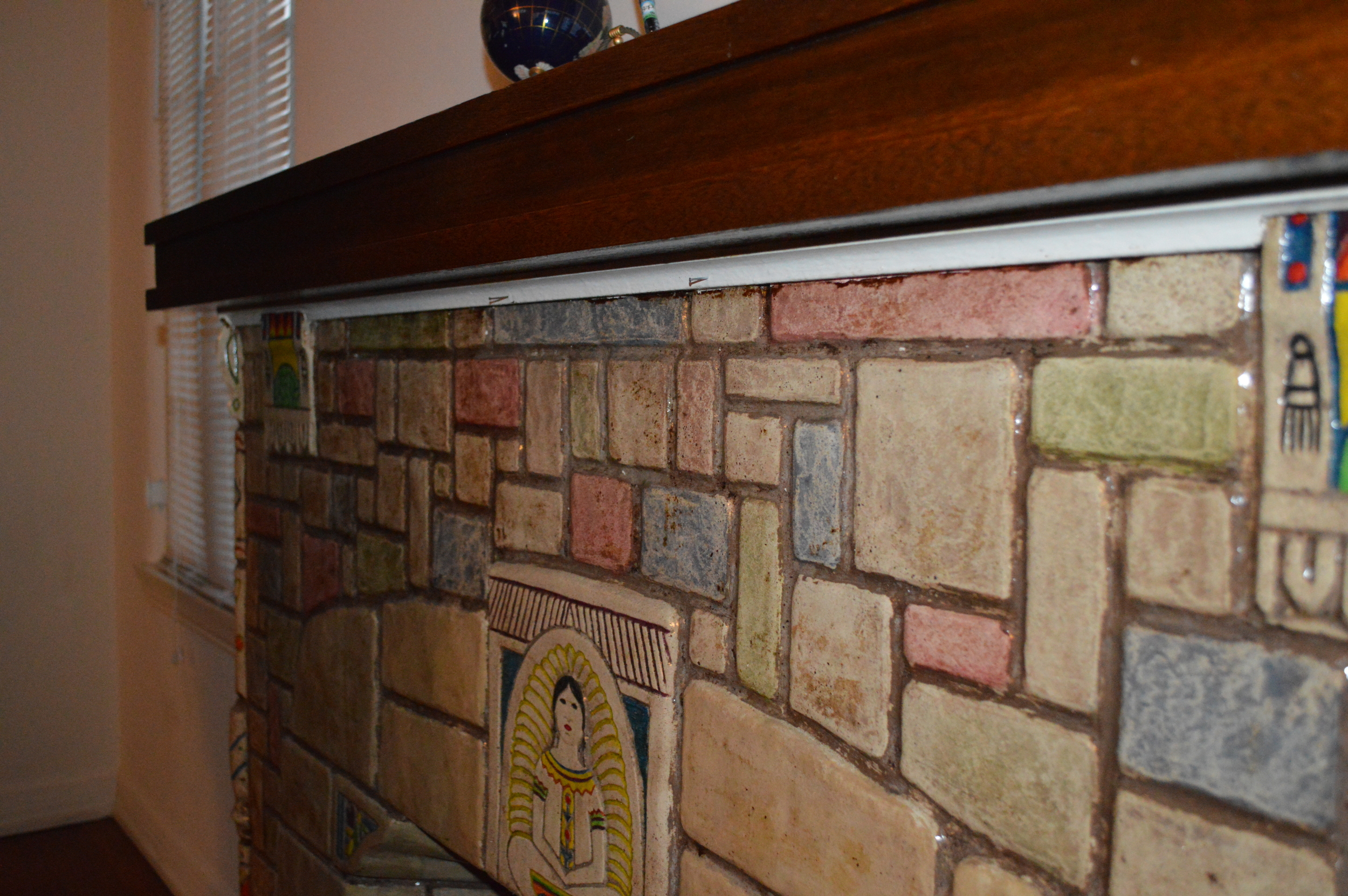 > Architectural mantel w/Batchelder tiles