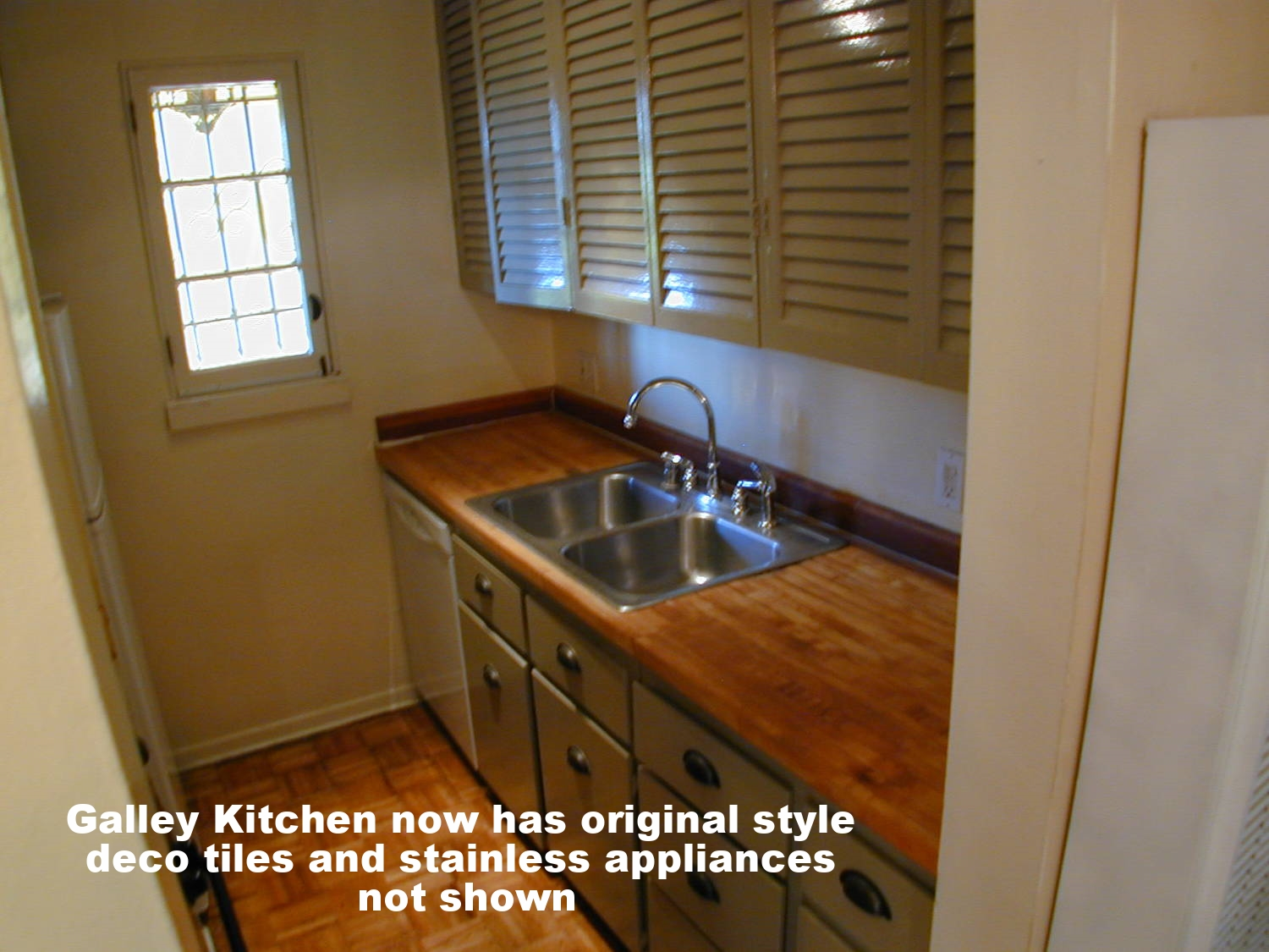 Galley kitchen, countertop shown has been upgraded from shown
