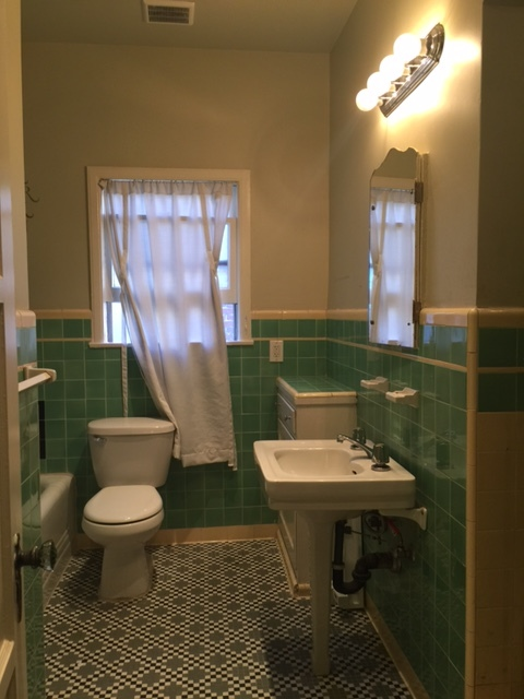 Original deco-tiled bathroom