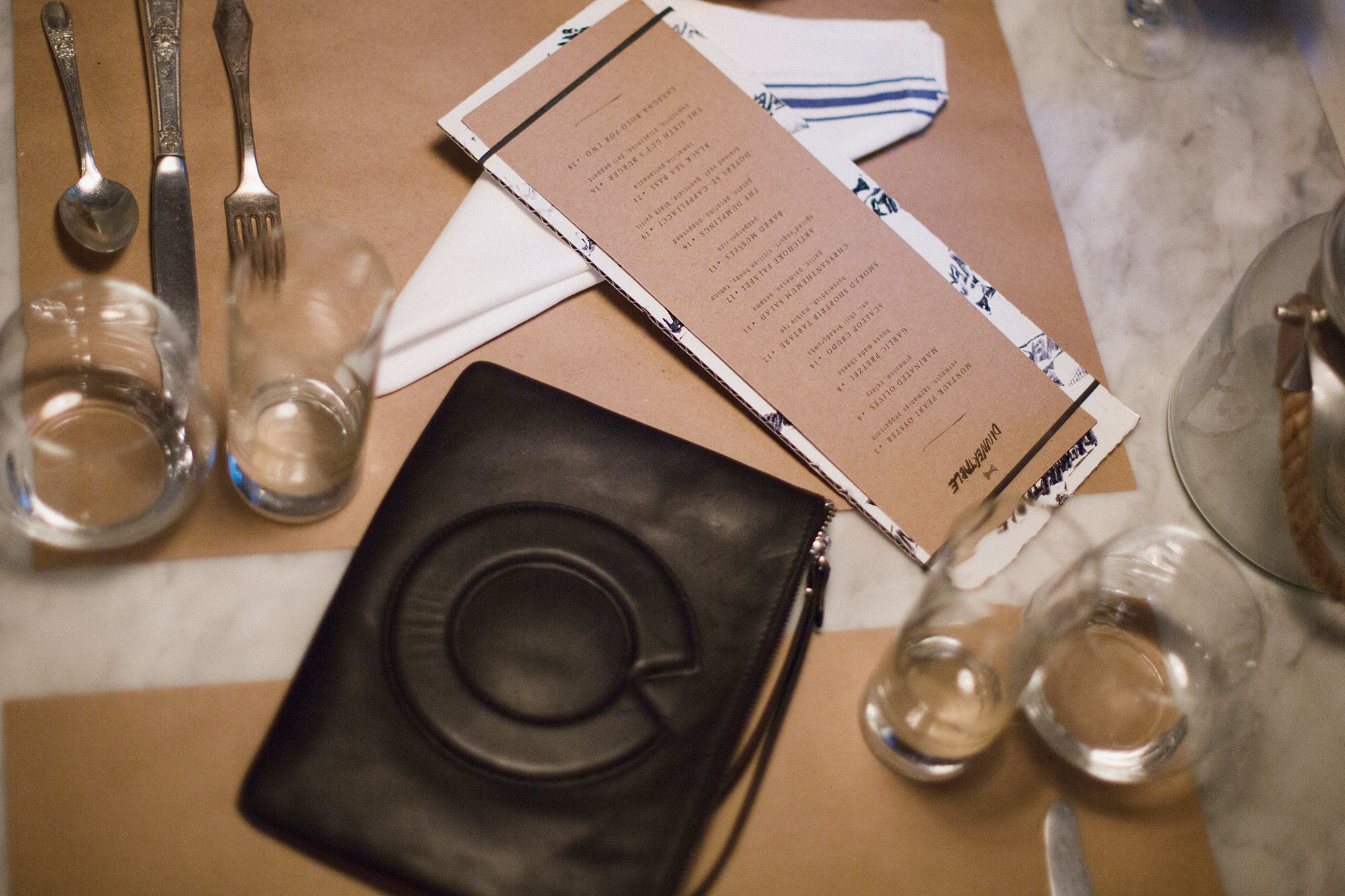 OVERT clutch at dinnertable by Den Hospitality