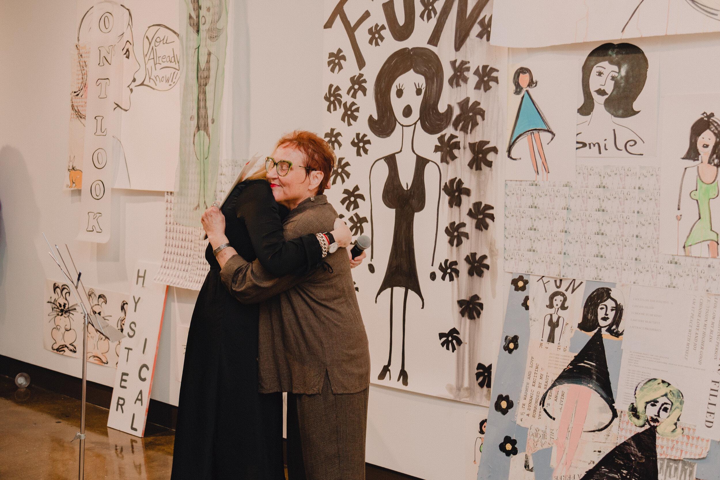 Debbie Millman hugs Pam Butler