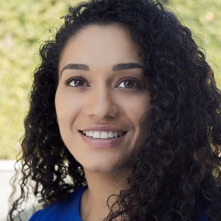 Julie Fernandez teaches trauma-informed yoga for Exhale to Inhale