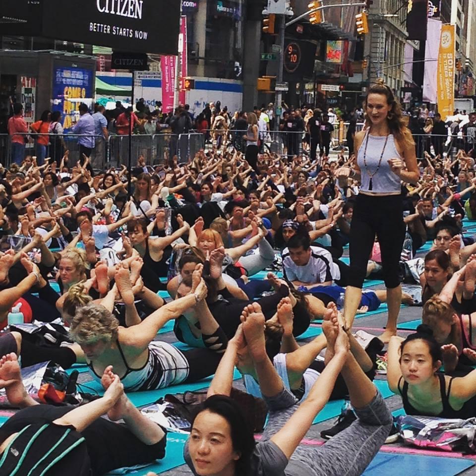 Sarah Platt Finger leads a yoga practice at Summer Solstice 2017