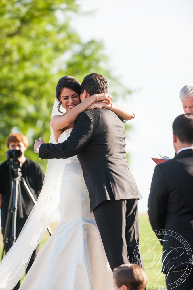An elegant summer wedding at Trump National Golf Course in Bedminster, NJ featuring romantic bridal portraits and artistic, photojournalistic imagery.