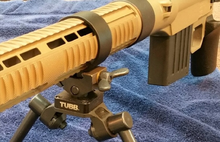 "Seen assembled are the new Tubb Non-symmetrical Bi-pod and ""Speed Ring"". The ""Speed Ring"" providing fast and versatile relocation of the bi-pod along the forend tube. Both are standard on the Tubb Adaptive Target Rifles."