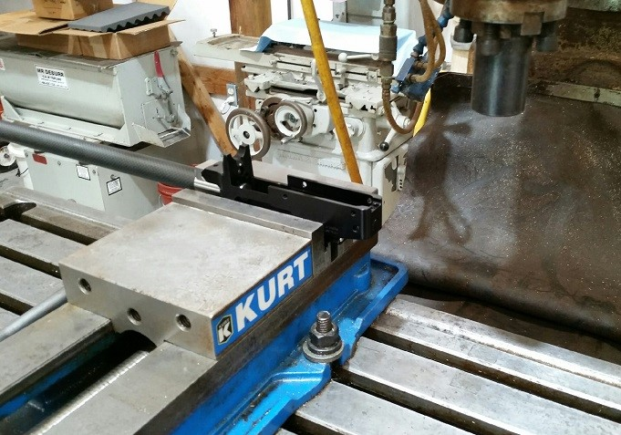 STEP-1: After cleaning the vise jaws to ensure no marks can be transferred to your receiver, clamp the barreled-action into the vise high enough that the stock can be attached without touching the vise jaws. Use parallels to locate receiver flat and square to spindle.