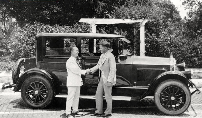 Master of Ceremonies  Jules Brazil  presents  Bobby Jones  with a 1926 Pierce Arrow on behalf of the City of Sarasota in a Welcome Home celebration of Jones' unprecedented (British) Open Championship victory as an American amateur.