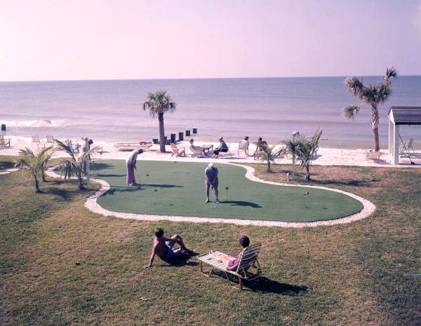 Guests at the putting green at the Holiday Lodge on the Gulf of Mexico, Longboat Key Florida.  Photograph c. 1972 by Joseph Janney Steinmetz, courtesy of the Steinmetz Collection of the State Library and Archives of Florida.