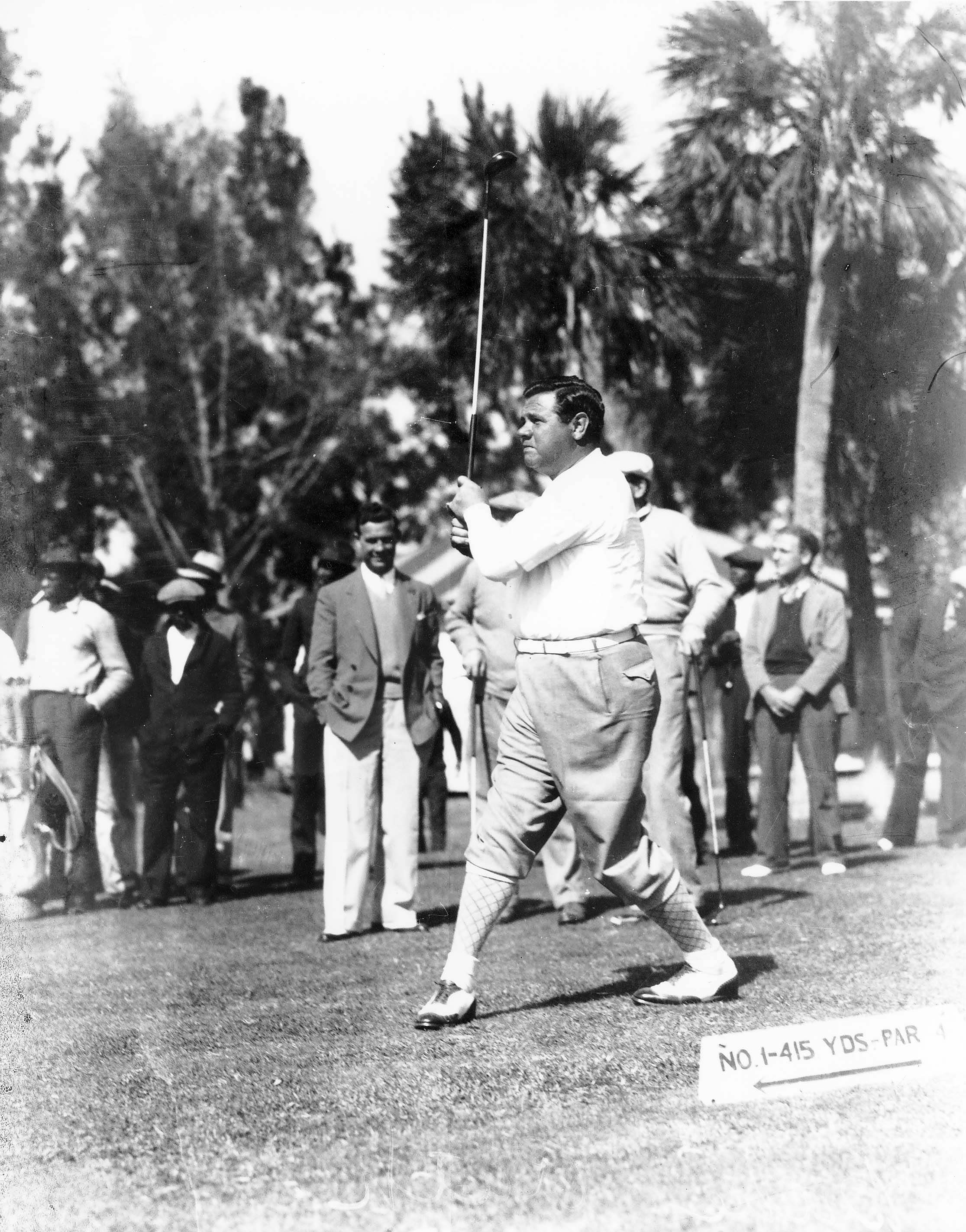 MONDAY FEBRUARY 3, 1936 - Babe Ruth  drives at The  Donald Ross  Course No. 1 Tee, 415 Yards, Par 4. Photograph courtesy of Sarasota County Historical Resources. Bobby Jones Golf Club Manager, Head Professional and President of the PGA of America  George R. Jacobus  admires the Babe's left-handed follow-through.