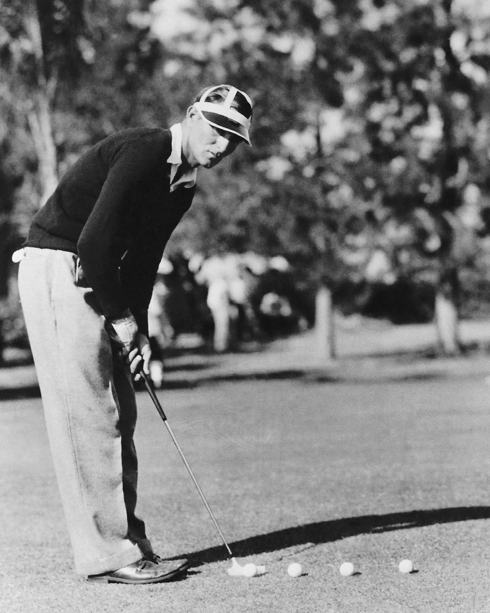 """SHARPENS BATTING EYE AT SARASOTA OPEN.  Paul Waner,  of the ""Poison Twins"" that being to the Pittsburgh Pirates, sharpens his eye before winter training begins for his club this season with a little putting. Waner is competing in the new Sarasota, Fla., $2,000 Open golf tournament."" ACME"