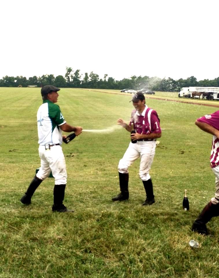 Bill Custer gets a congratulatory champagne spray!