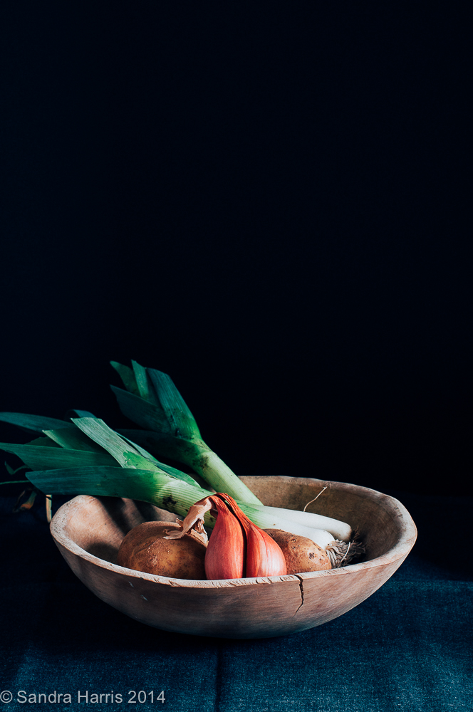 leeks, potatoes and shallots in an old wooden butter bowl - Sandra Harris