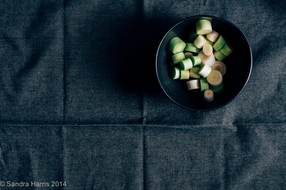 shallots in a black bowl - Sandra Harris