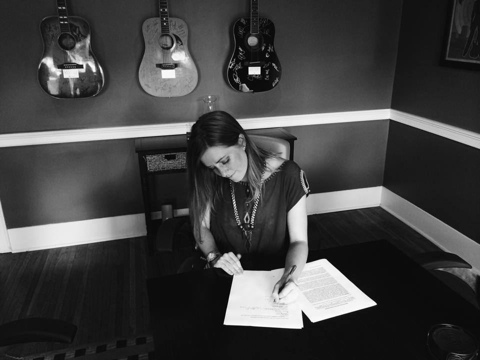 signing a licensing and distribution deal with Dualtone Records.