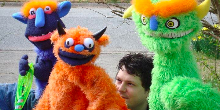 Beau Brown with some puppet friends. Hint: Beau is the one without seams.