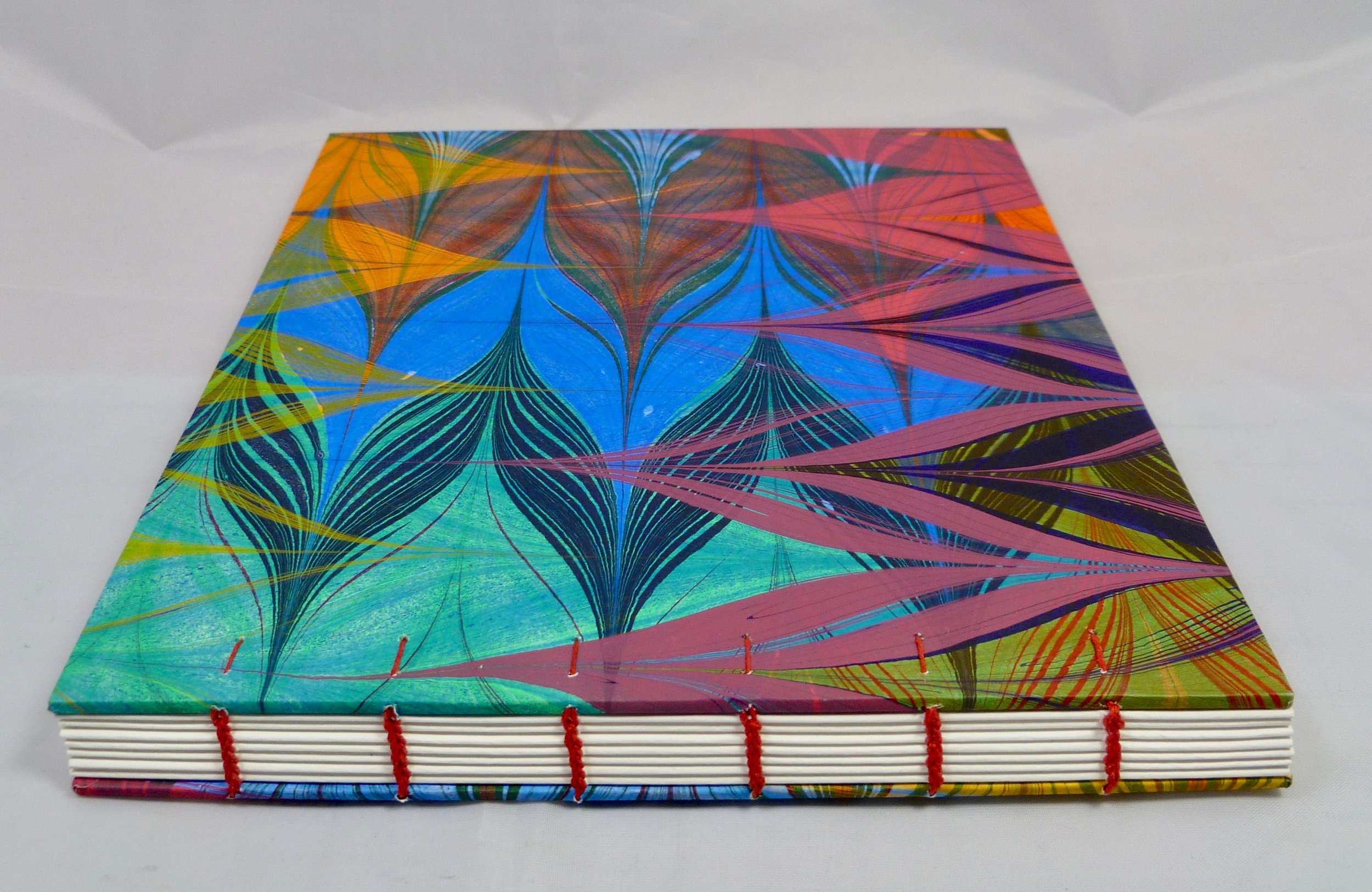 PassionatoBooks - Unique hand-sewn journals with covers of marbled, Japanese, maps or design papers by Laurel Rogers