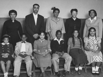 The plaintiffs in the case and their children:  (front row) Vicki Henderson, Donald Henderson, Linda Brown, James Emanuel, Nancy Todd, and Katherine Carper; (back row) Zelma Henderson, Oliver Brown, Sadie Emanuel, Lucinda Todd, and Lena Carper.