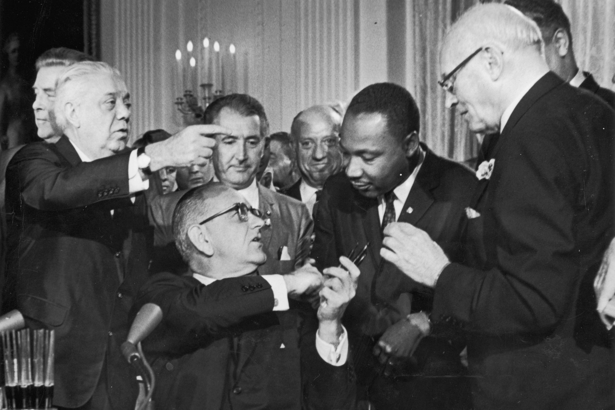 President Lyndon Johnson and Dr. Martin Luther King, Jr. shake hands after Johnson signed the Civil Rights Act into law.