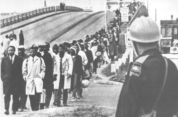 This photograph was taken on March 7, 1965. Approximately 60-70 Alabama state troopers and others met approximately 650 African Americans as they crossed the  Edmund Pettus Bridge  in a march from Selma to Montgomery, Alabama.