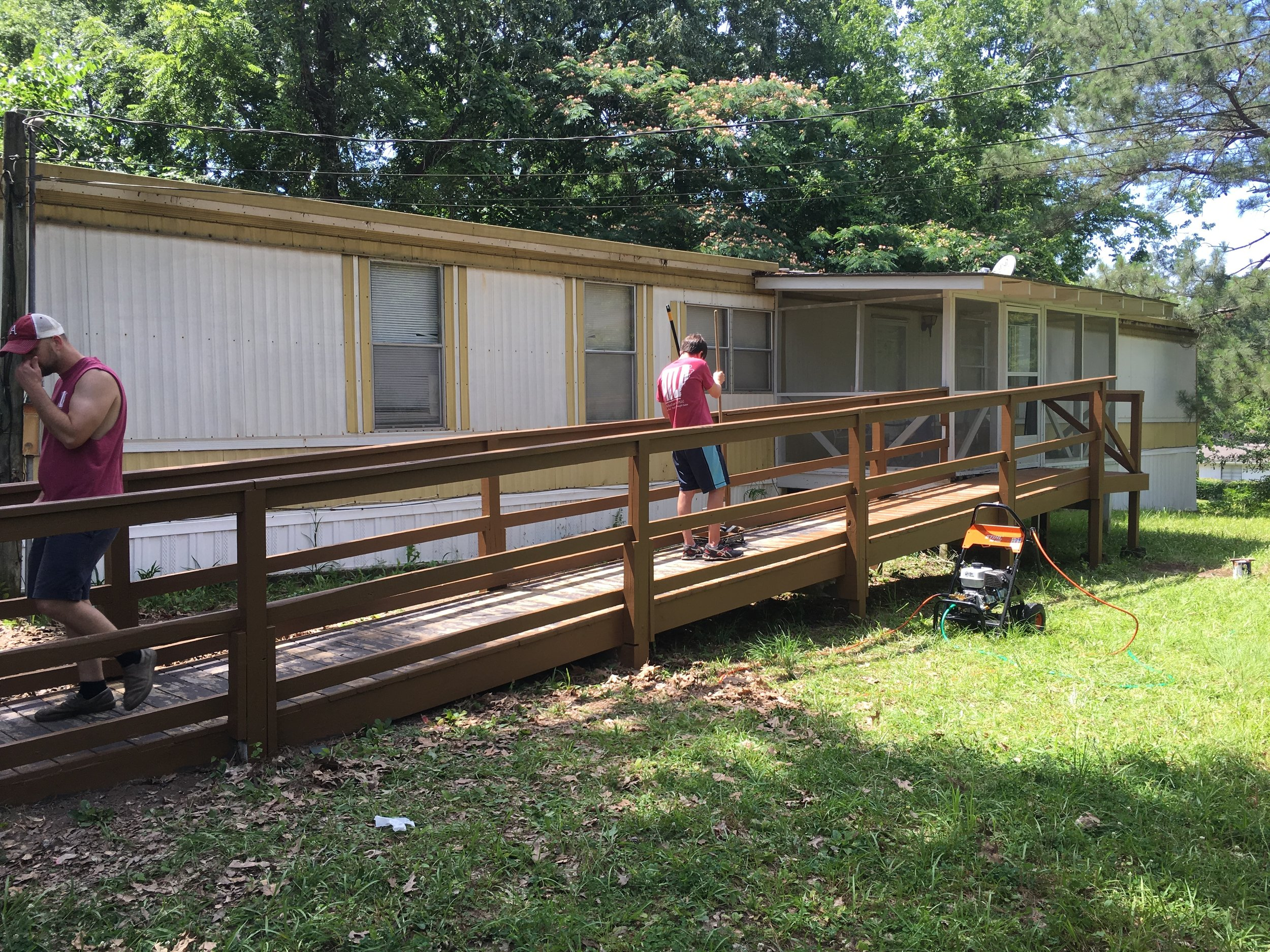 Pictured above are Jay Neal (left) and Austin King (right) finishing up the paint job.