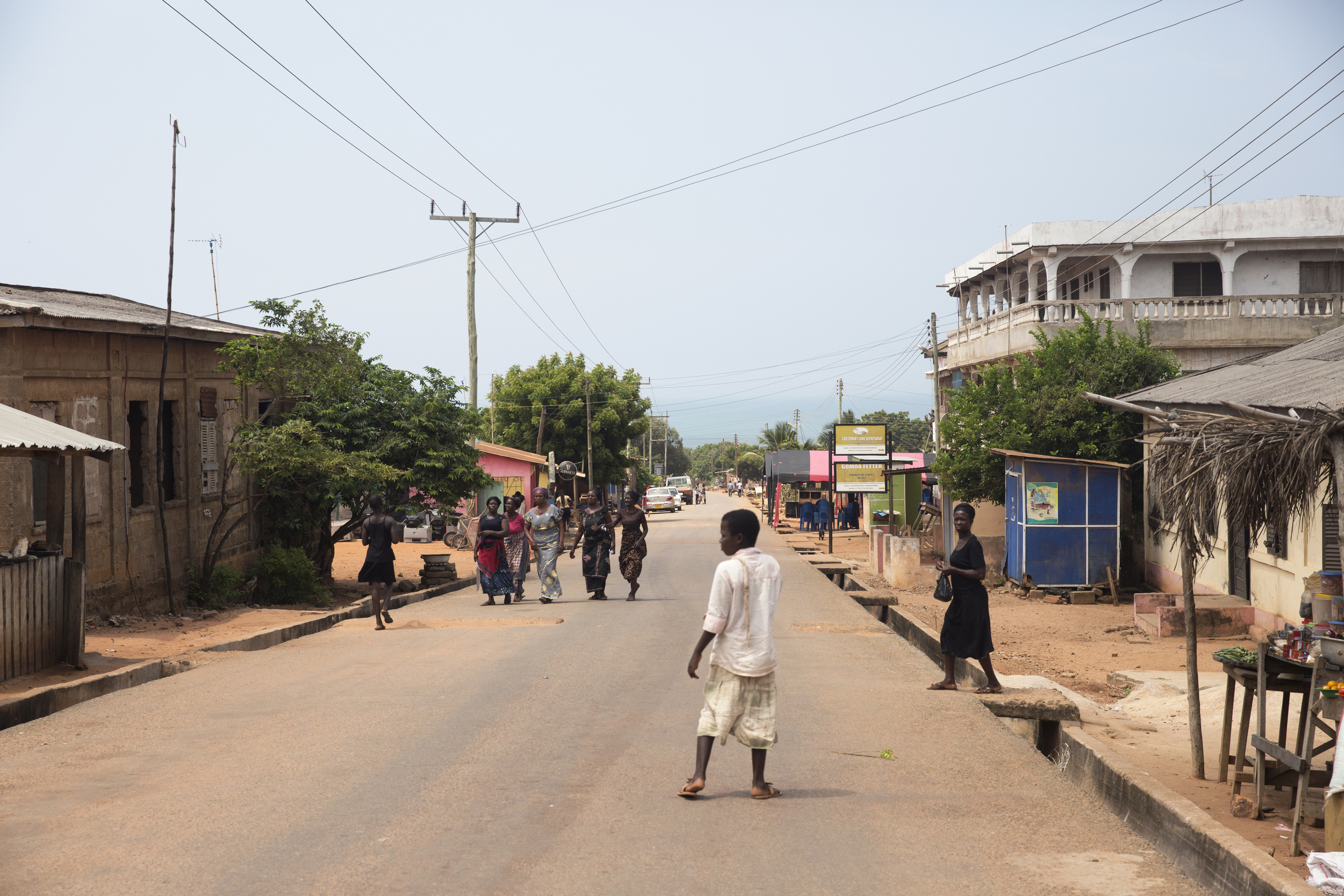 A street view of the village that we ended up in. The women in black and red are on their way to attend a funeral.