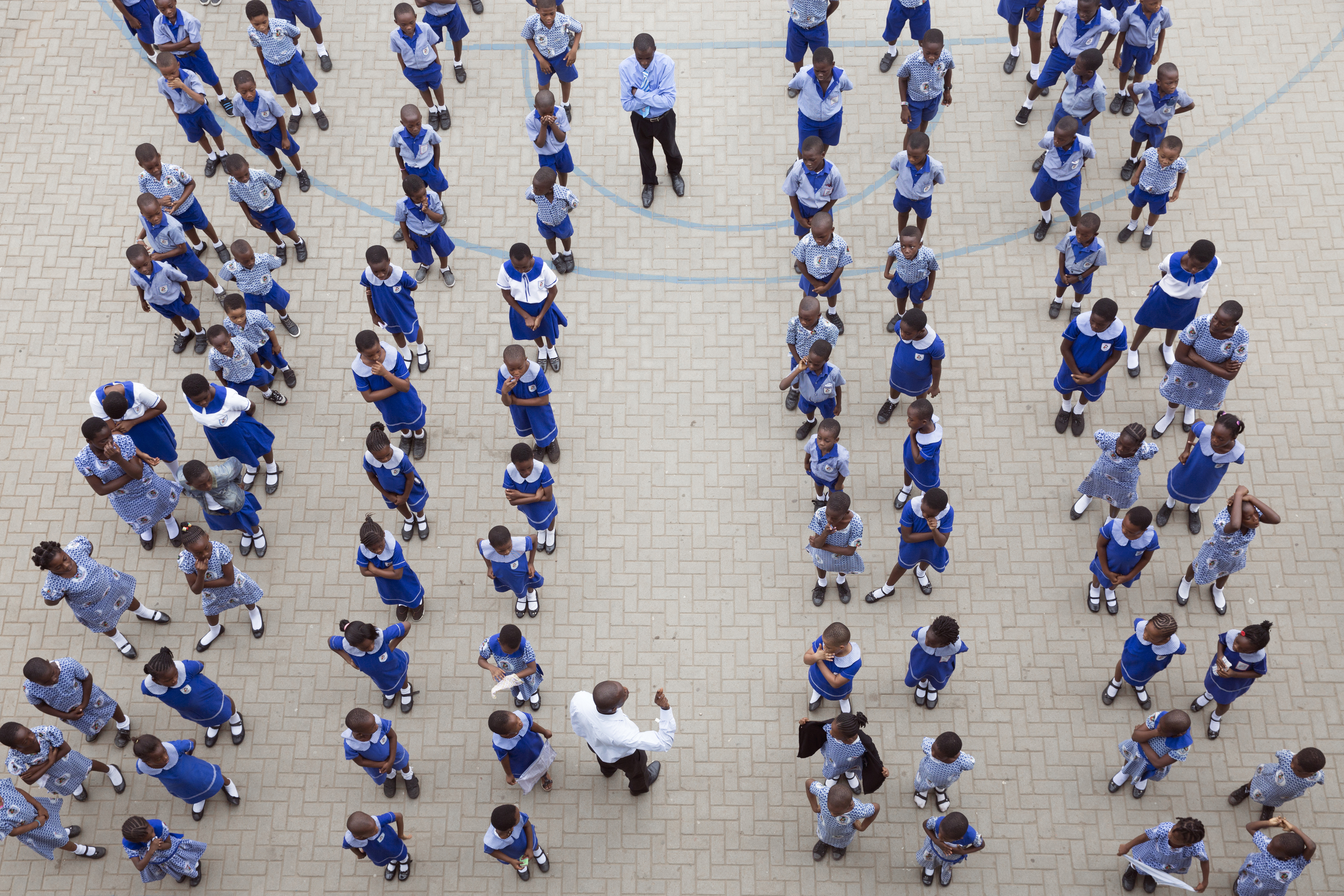 Brainbirds students (not all included) line up in their uniforms for their morning assembly.