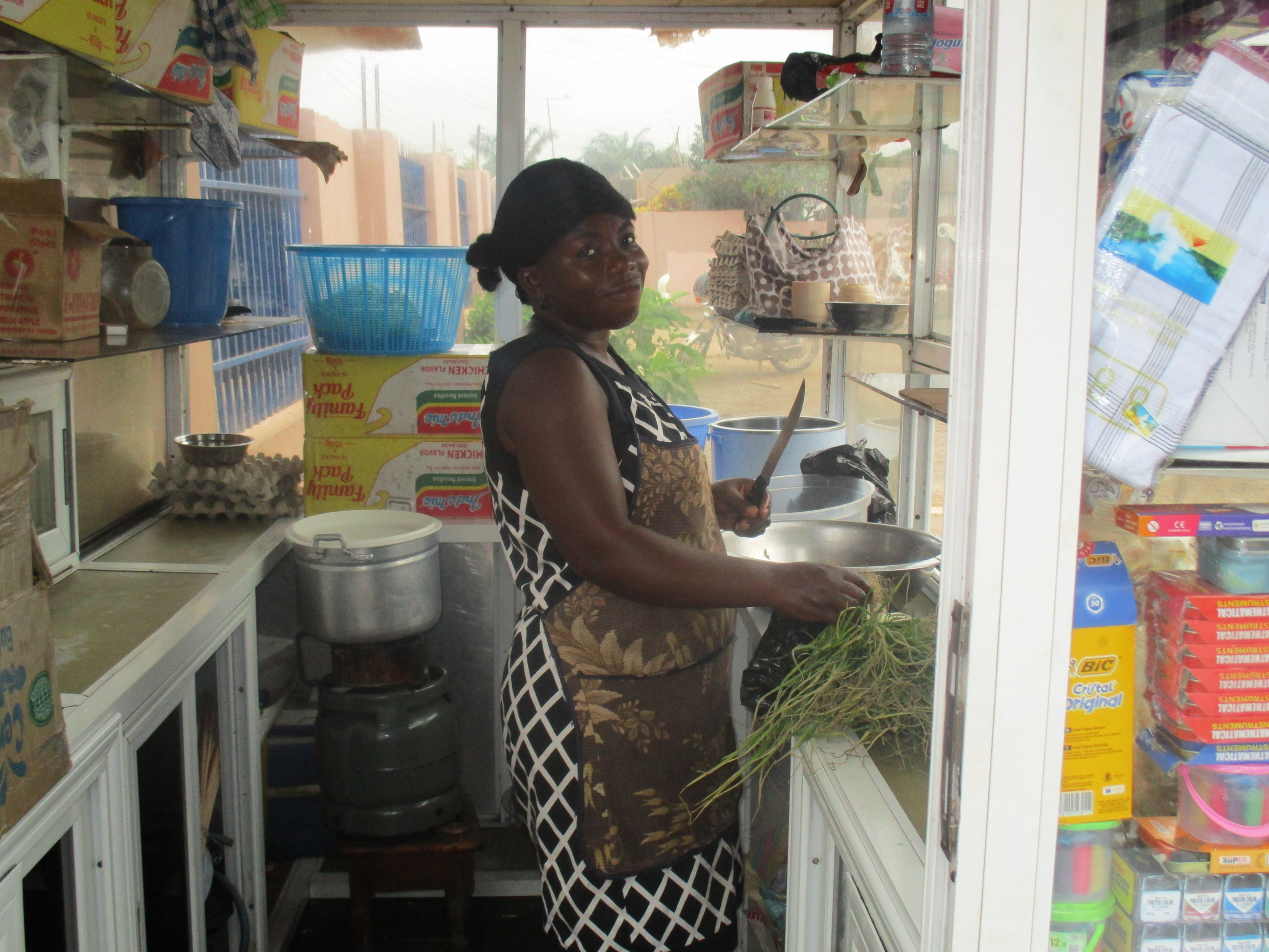 """""""Mame"""" (the lady who sells indomie instant noodles at the school) is photographed by  Elizabeth, Form 1."""