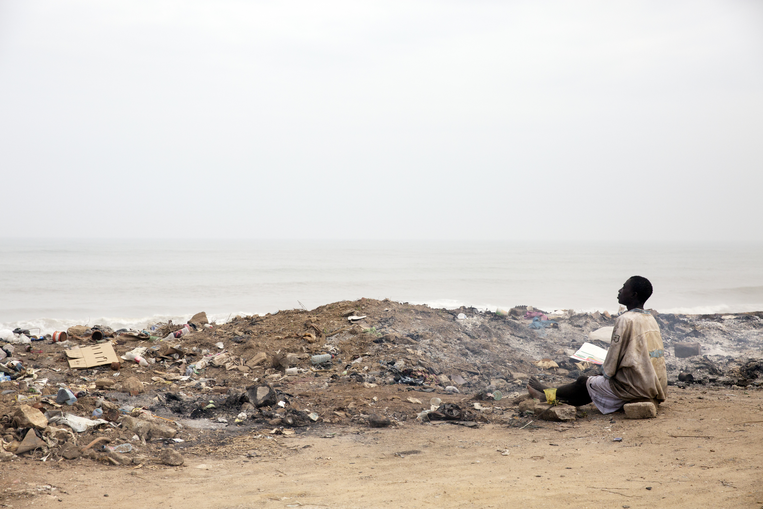 The man praying in front of the trash... I can't even describe how peaceful the look on his face was.