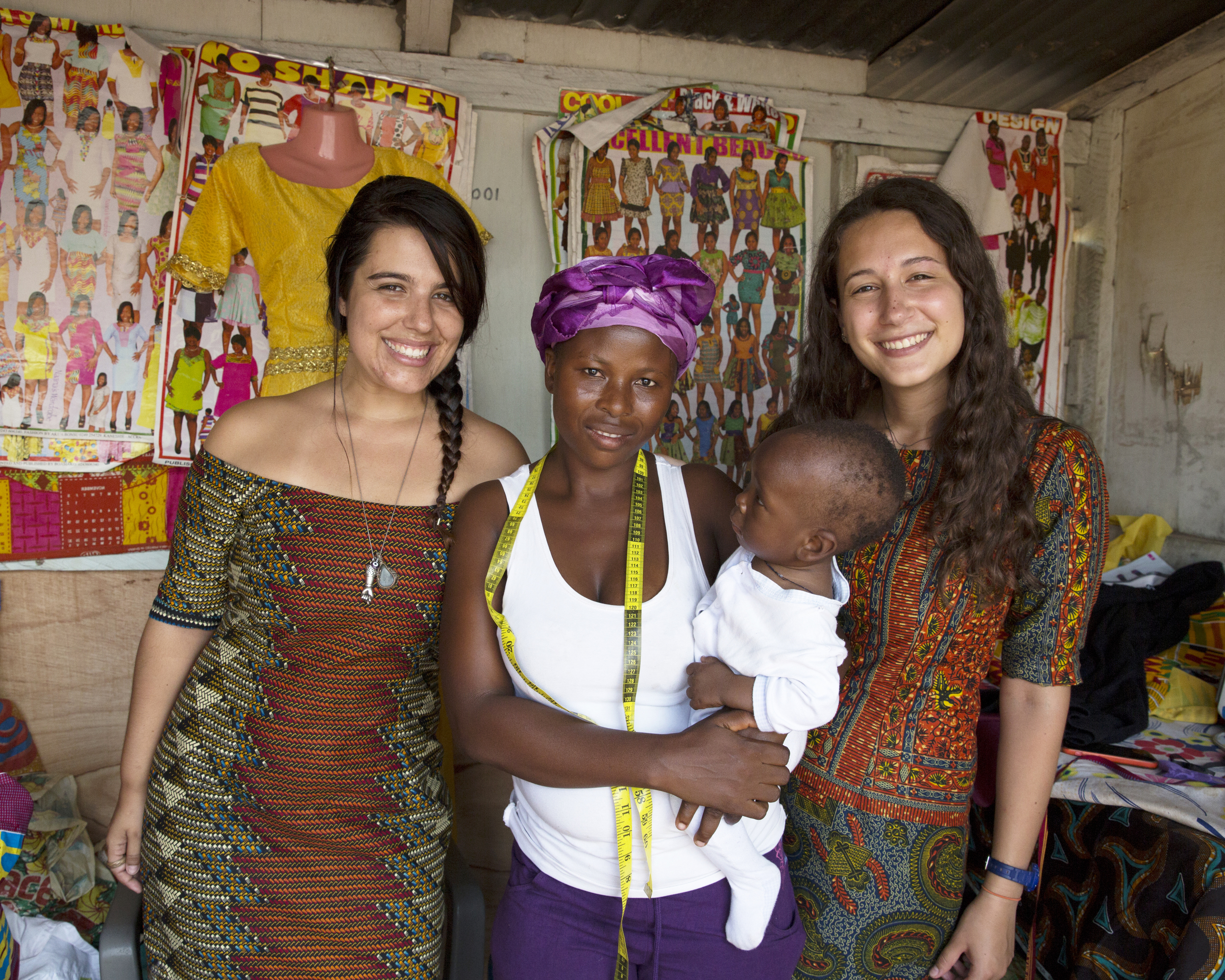 Mariana and I pose for a photo with Mary and her son while wearing our beautiful new dresses.