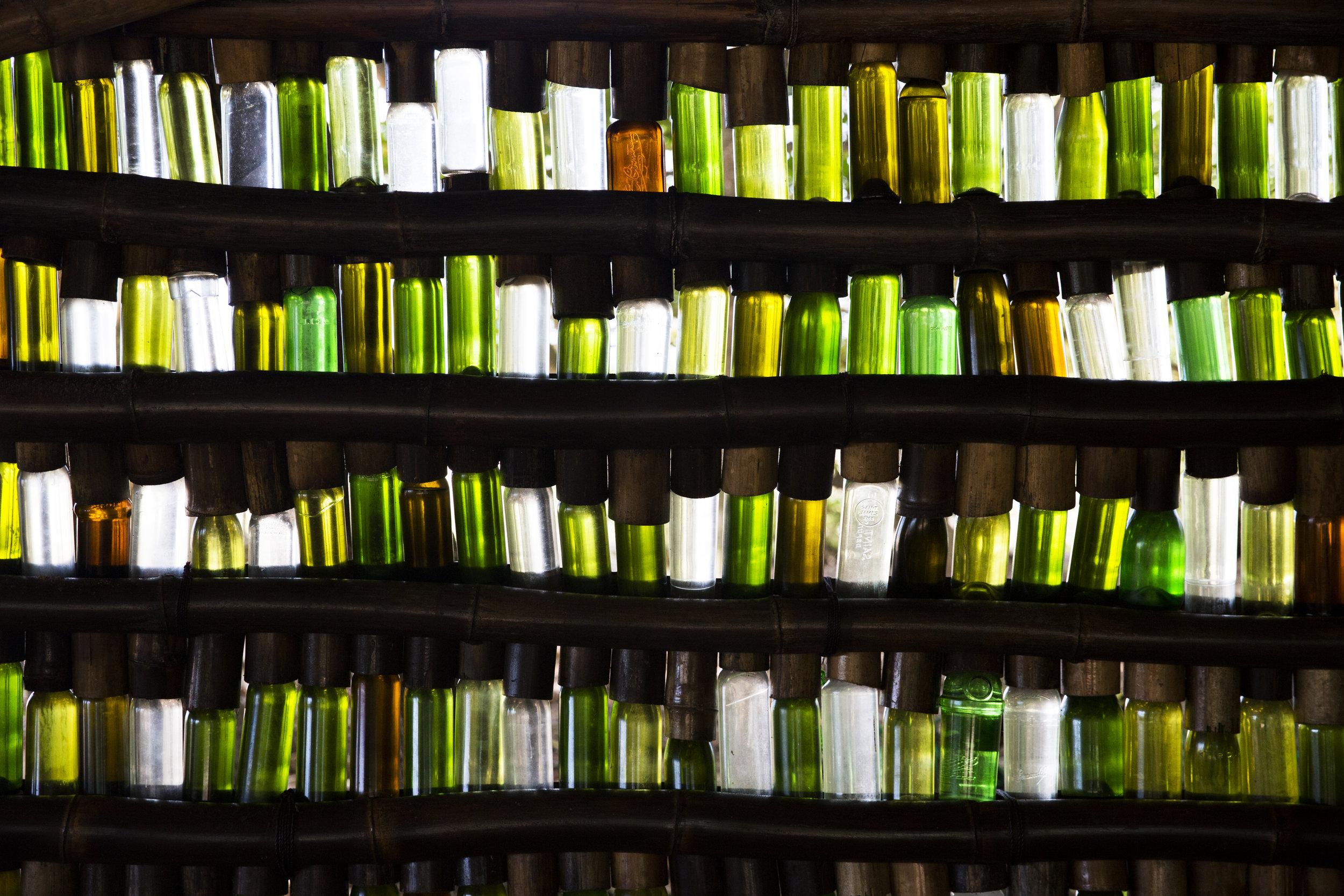 Glass bottles reused as bar decoration