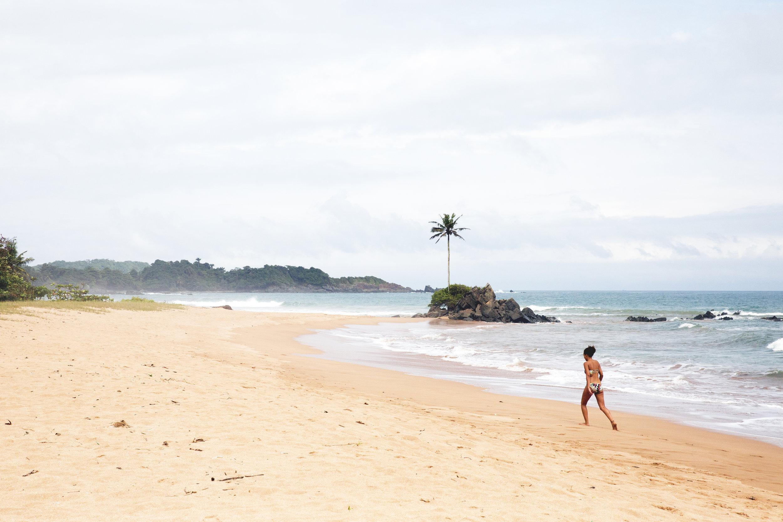 Theresa walks along the shore