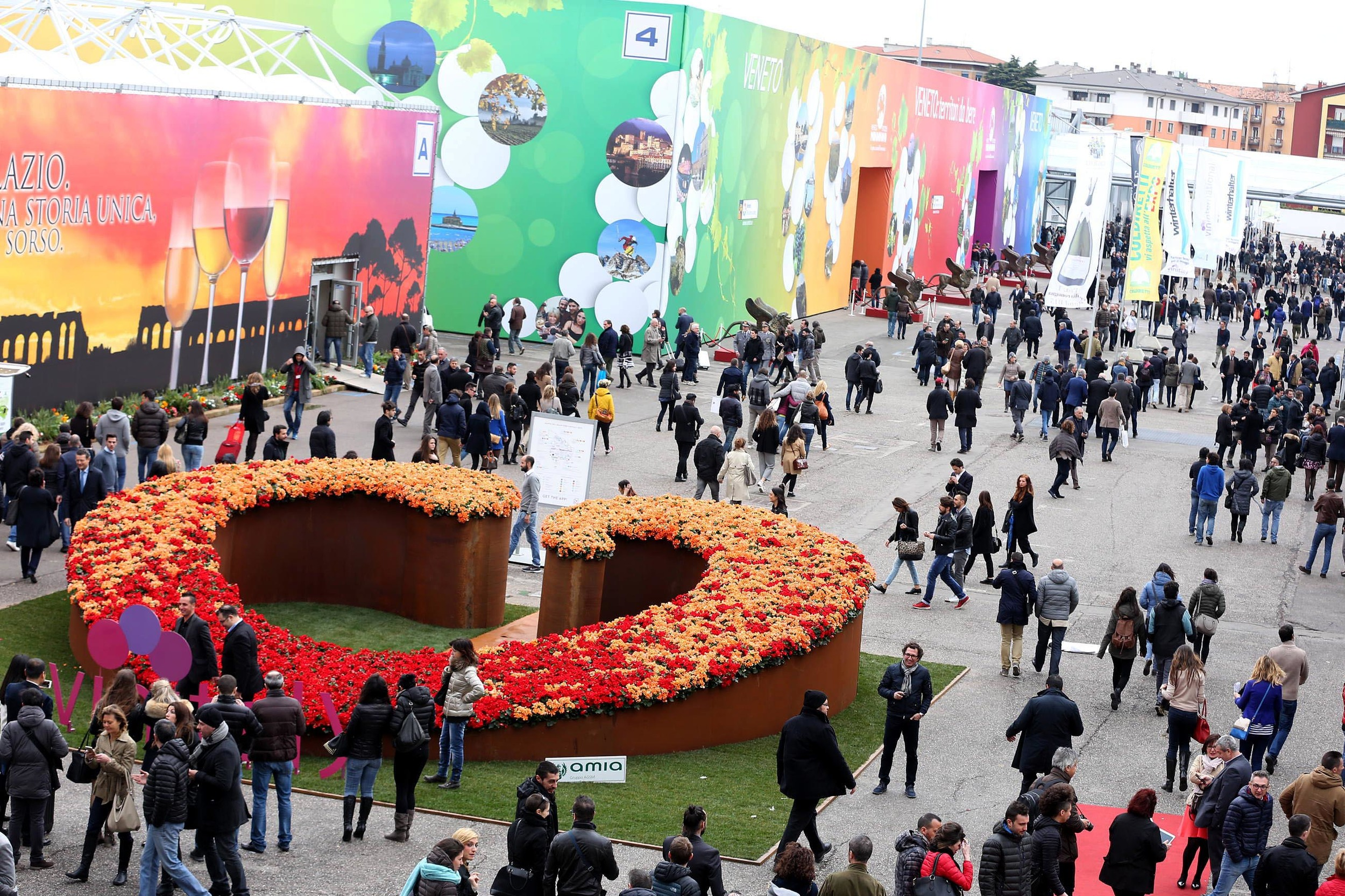 The colourful exhibition halls at Vinitaly are packed with wines from more than 4,000 wineries