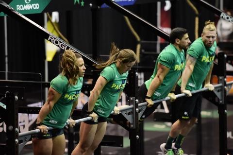Team Pacific hitting synchro muscle-ups,  Nikon D4s, Nikon 70-200, 1/640th,  F2.8, ISO 6400,, Copyright CrossFit, Inc 2016