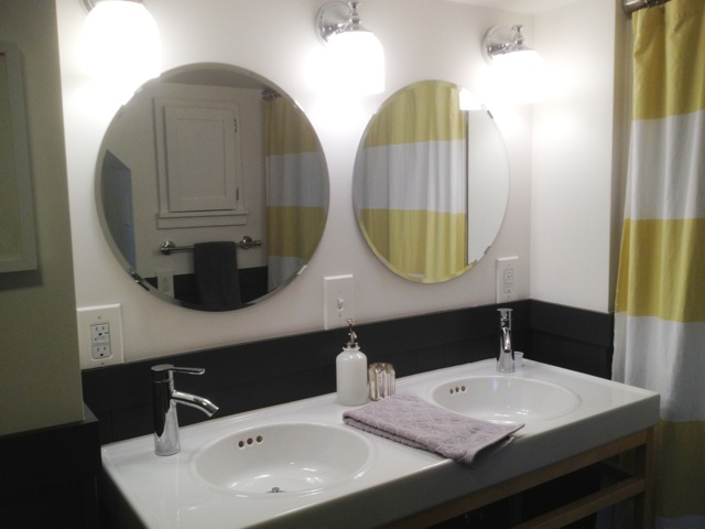 Double sinks, faucets, and mirrors are from IKEA (MOLGER). The lights are from Pottery Barn.