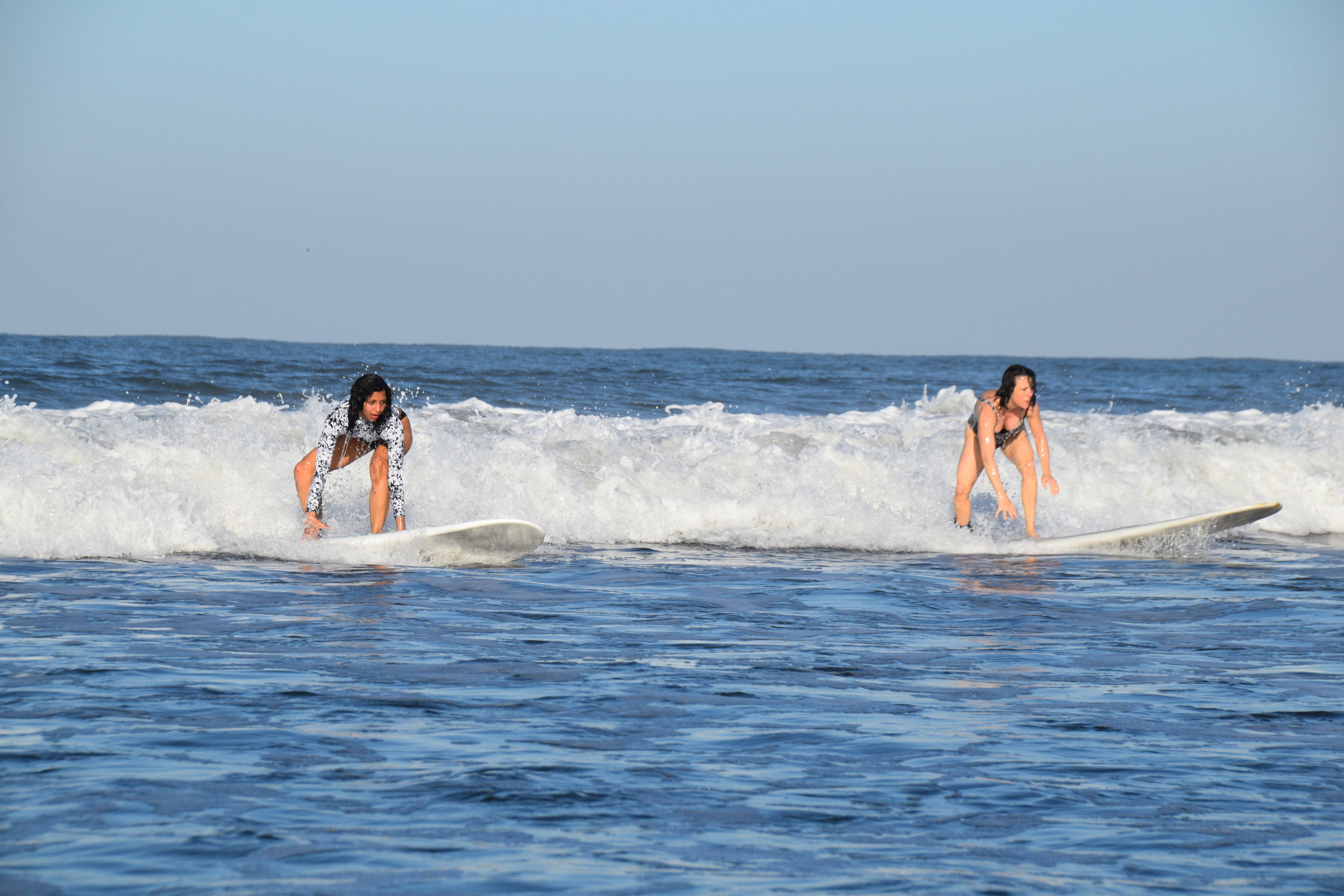 Francesca and Annie surf