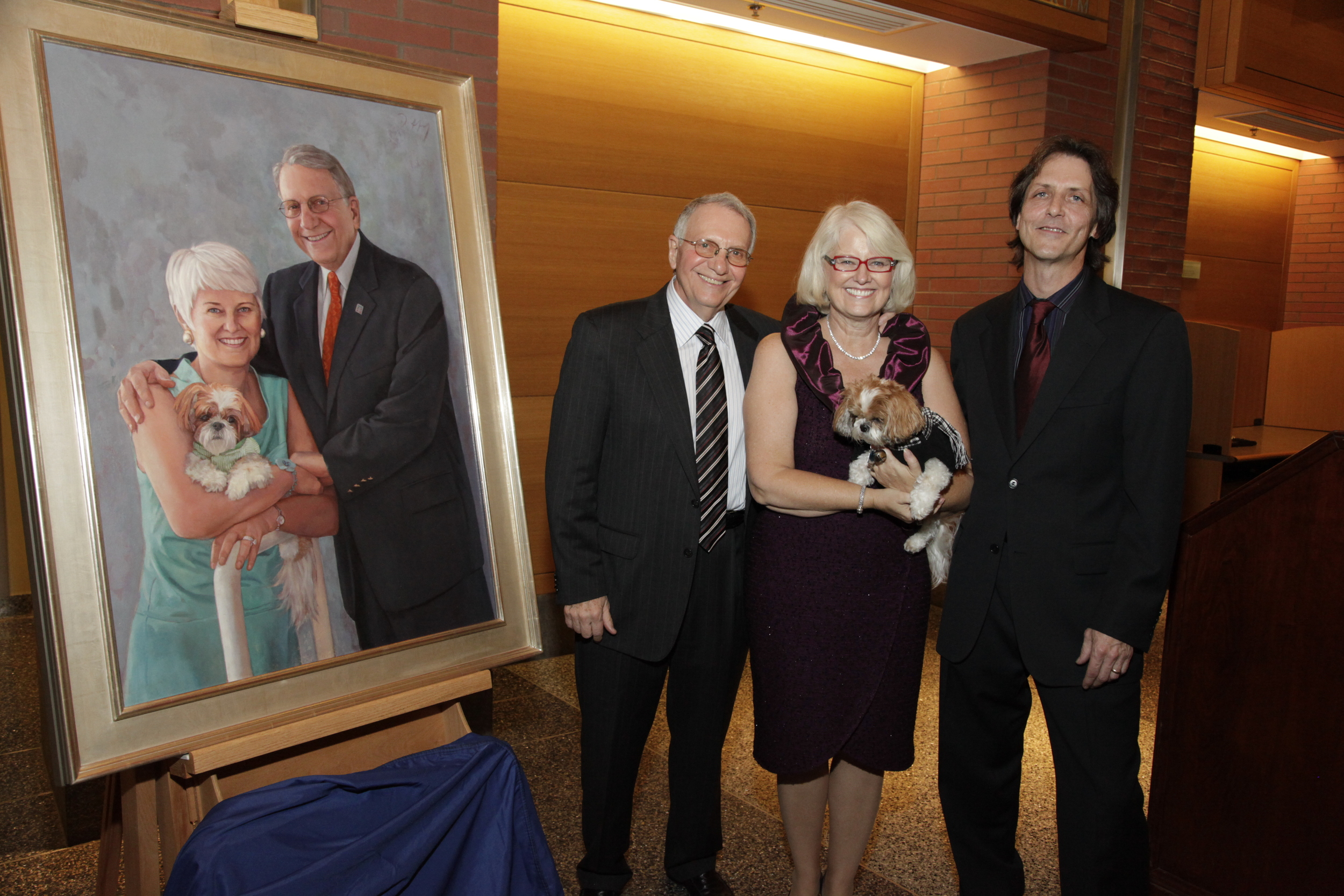 Jay and Patty Baker with the artist Daniel Duffy. Photo by by Dr. Amy Gutmann, Penn President