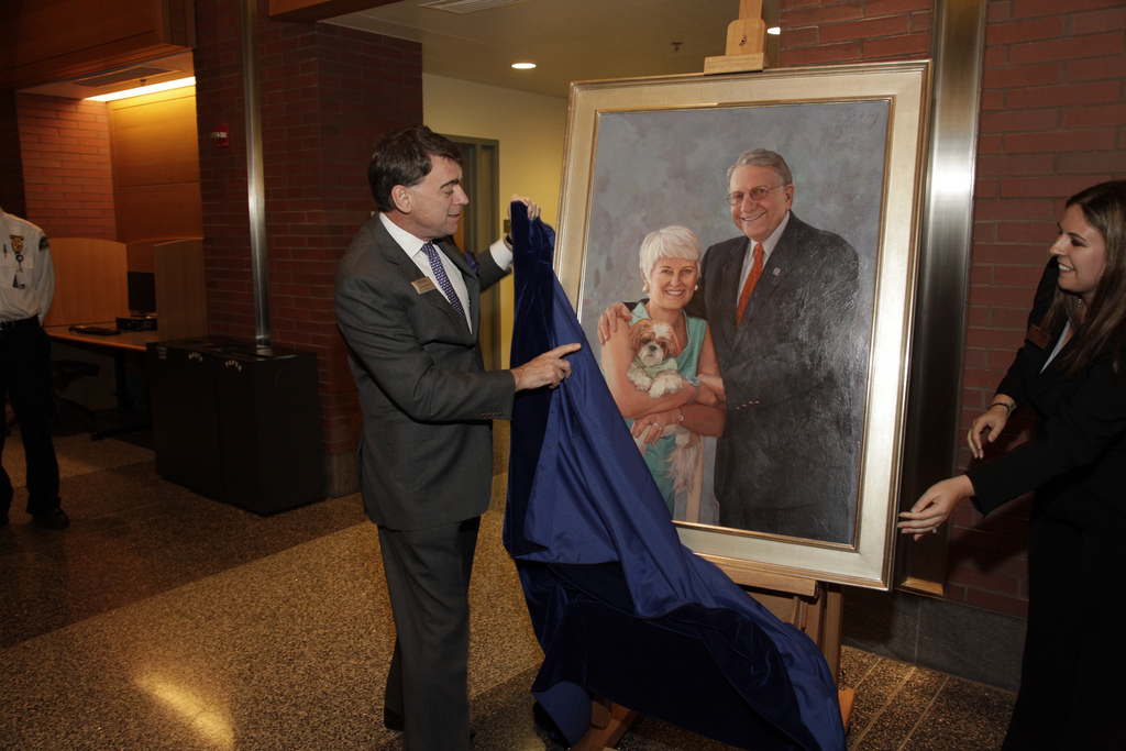 Thomas Robertson, Dean unveils Duffy's portrait of Wharton trustees Jay and Patty Baker. Photo by Dr. Amy Gutmann, Penn President