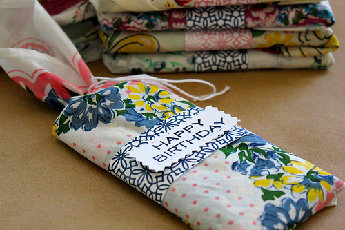 We loved this idea from Crafted by Lindy. What a wonderful way toturn something generic, like a candy bar, into a distinctive gift with whimsical cotton fabric.