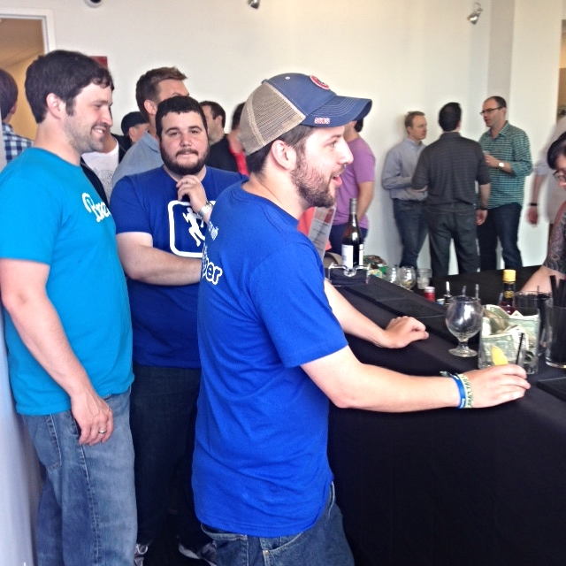 The RunKeeper team ordering up drinks at the bar.