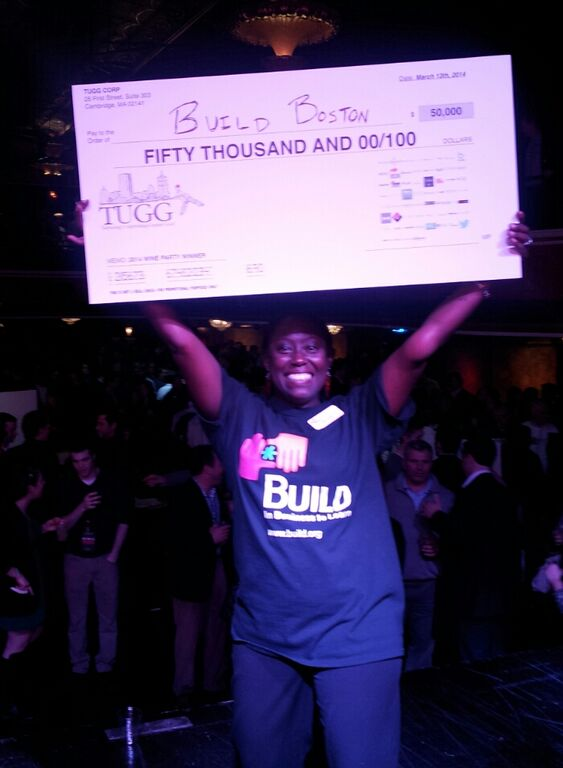 BUILD Executive Director Ayele Shakur celebrates a Wine Party win!