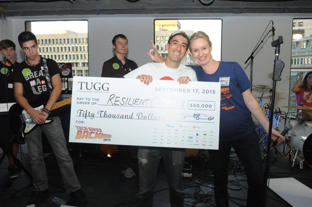 7.5 months pregnant and awarding David Delmar of Resilient Coders a $50k grant at 2015 Tech Gives Back