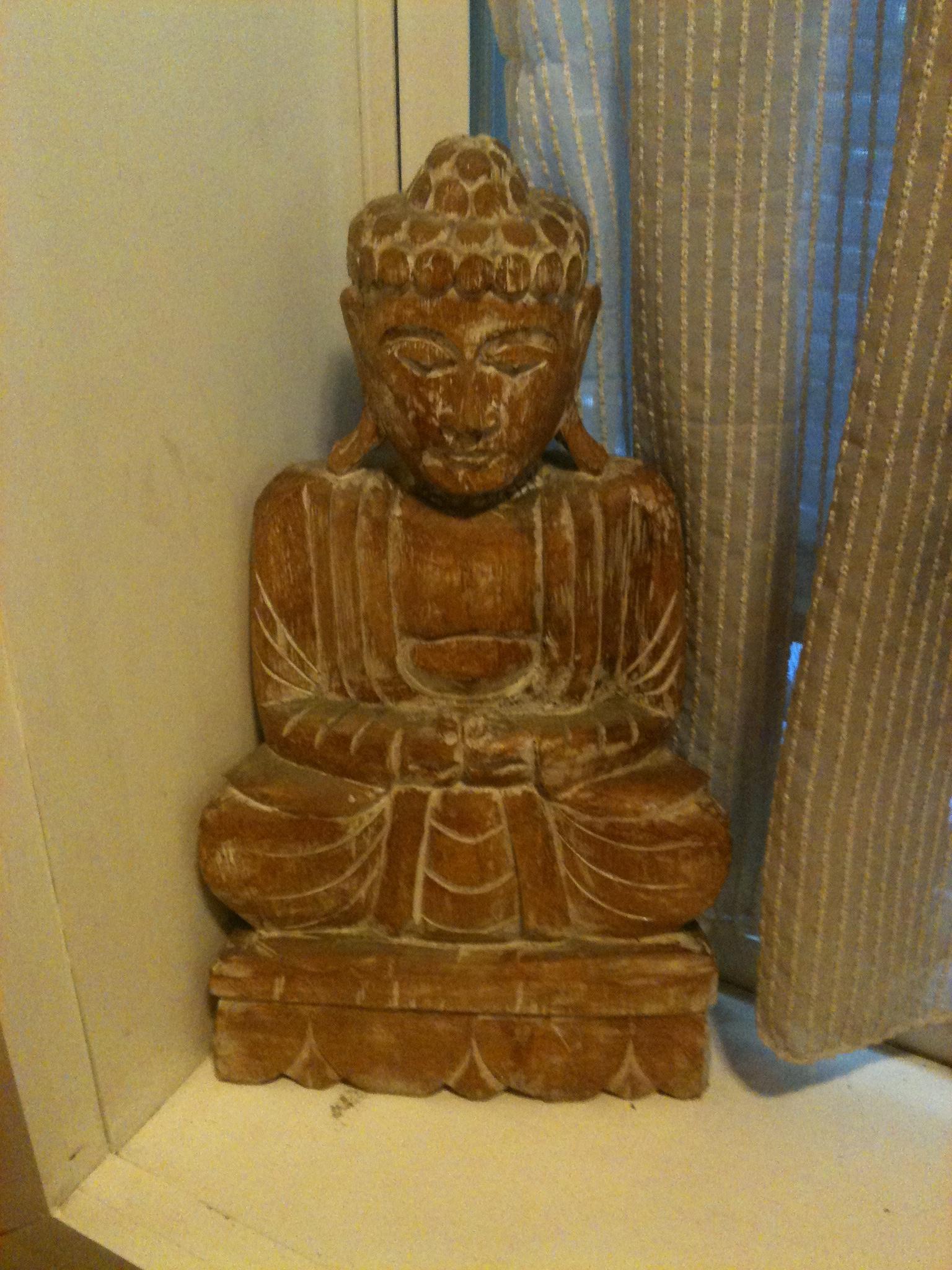 Giant Buddha watching over patrons of the Good Karma Café bathroom...