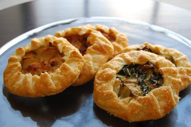 kale, potato and parmesan galettes, caramelized onion, apple and cheddar galettes